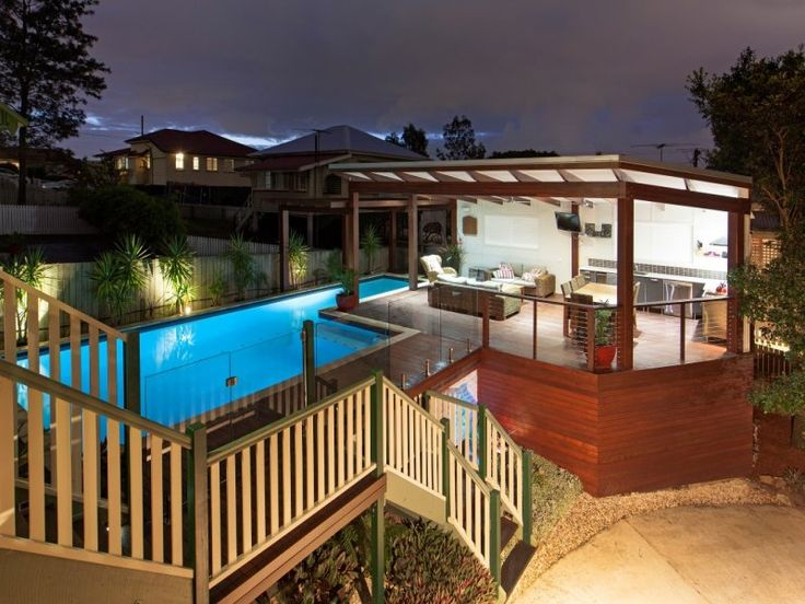 Modern deck & pool.  I couldnt be happier with how this deck and lap pool turned out.  Hardwood posts, rafters and decking look great with contrasting white ceiling.  Frameless glass pool fence and custom lighting finish the deck off nicely www.empiredesigns.com.au