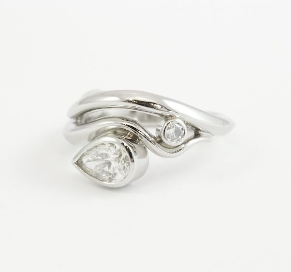Platinum wave engagement ring with 0.79ct pear cut diamond. Engagement rings Cork.