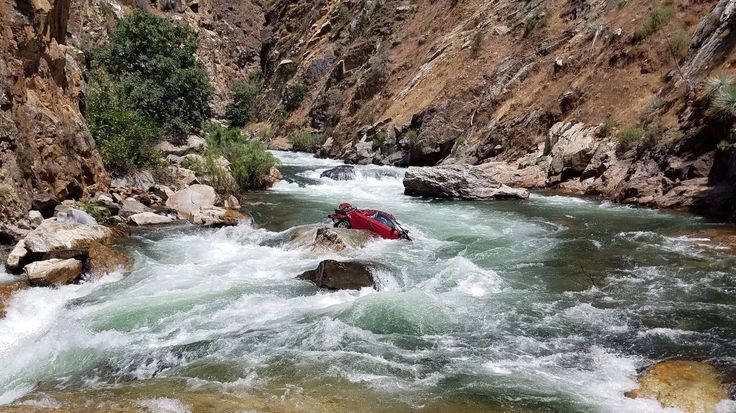 Two bodies pulled from a mangled car that had been trapped for weeks in the middle of a treacherous Kings River gorge in Central California were confirmed to be that two missing Thai students.