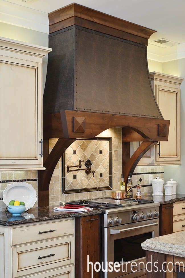A Custom Leather Trimmed Hood Conceals The Cooktop Vent