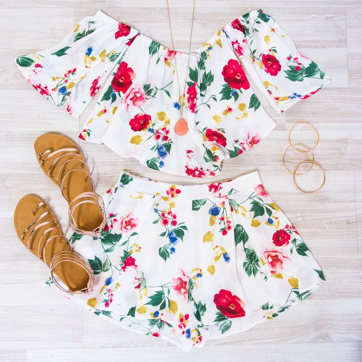 You'll want to wear the A Little Sunshine Floral Shorts all summer long! Sweet, silky and full of fun! Created with a lightweight, silky fabric, the breezy shorts with front pleats will move with you from shopping to happy hour. Bright florals burst off the white backdrop. Elastic waist and pull-on styling. Pair with neutral wedges to compete the look!
