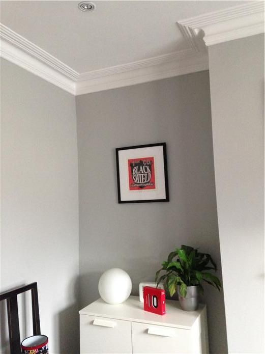 An inspirational image from Farrow and Ball Bedroom walls in Pavilion Gray and cornicing and ceiling in All White. The white cornicing contrasts beautifully with the grey walls. Pavilion Gray is very soothing, ideal for our bedroom.