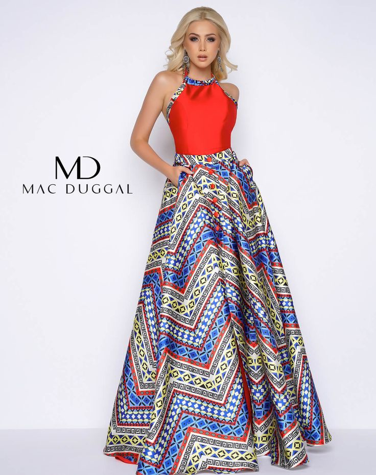 If you're looking for a nontraditional prom dress, choose this romper with chain halter neck and overskirt. This detachable button up Aztec printed overskirt includes pockets and a high slit!