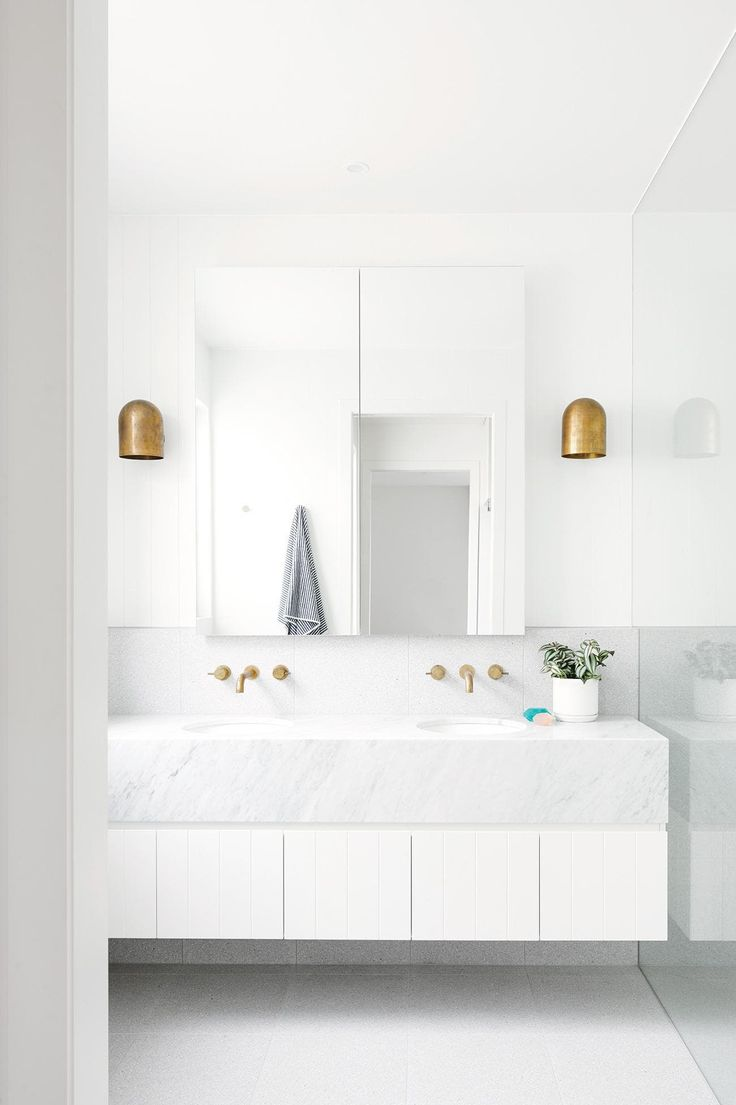 "Natural light streams into the bathroom, where Carrara marble from <a href=""http://www.signorino.com.au/"" rel=""noopener"" target=""_blank"">Signorino</a> forms the vanity. Photography by Nikole Ramsay. Styling by Emma O'Meara"