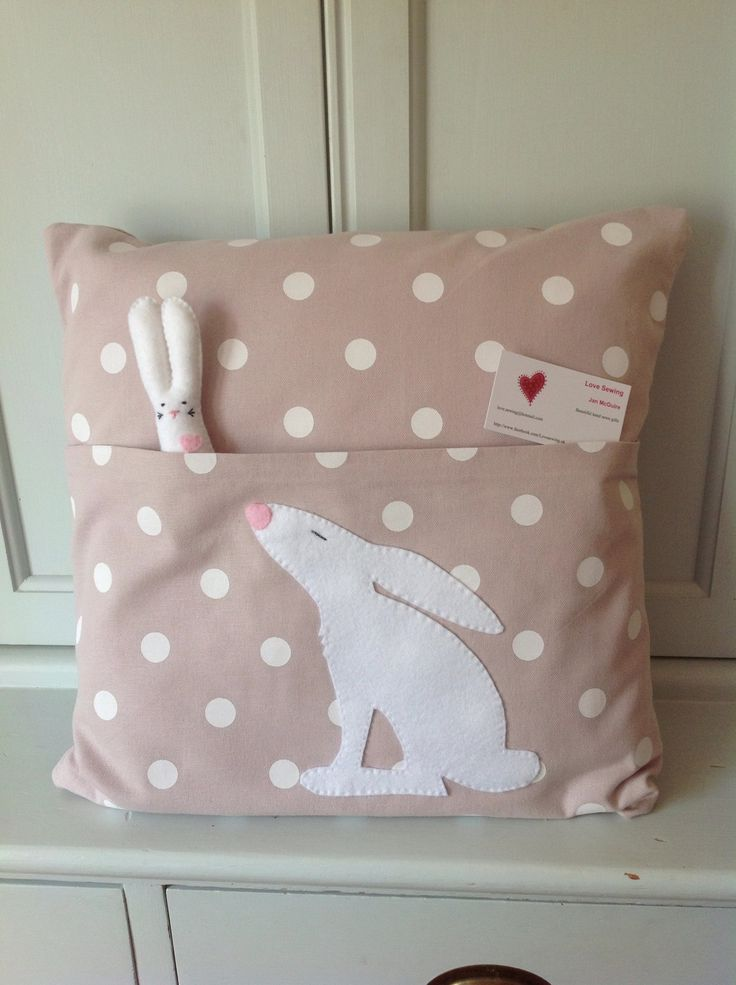 Designed & hand sewn by Jan McGuire: a reading pillow with Christmas Hare & baby felt hare# www.facebook.com/Lovesewing