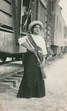 A female Mexican soldier before leaving the battle in Mexican Revolution via…