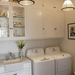 laundry room with sink, add toilet and shower and have basement all purpose bathroom!
