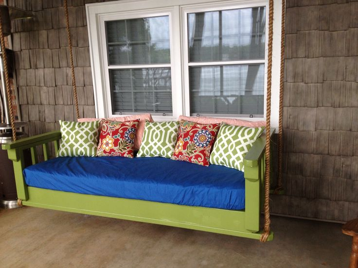 Porch bed swing!  Made by my son in law based on instructions from http://club.conservationgardenpark.org/2012/08/diy-blogger-house-tutorial-hanging-daybed-swing/. He hung it using thick cable that he covered in rope for a rustic look.  I bought a twin mattress and covered it with a waterproof cover.  I LOVE IT!