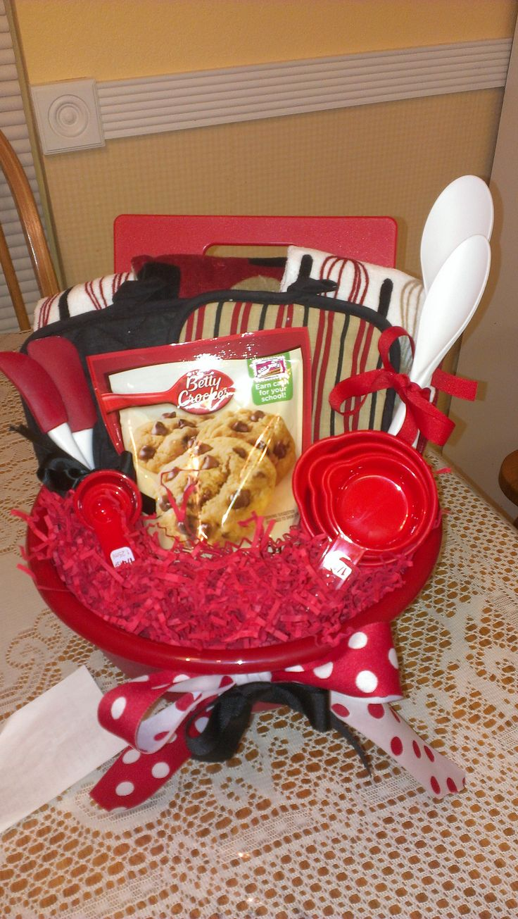 Housewarming gift - kitchen bowl with hot pads, spoons, cutting board, measuring cups, etc.