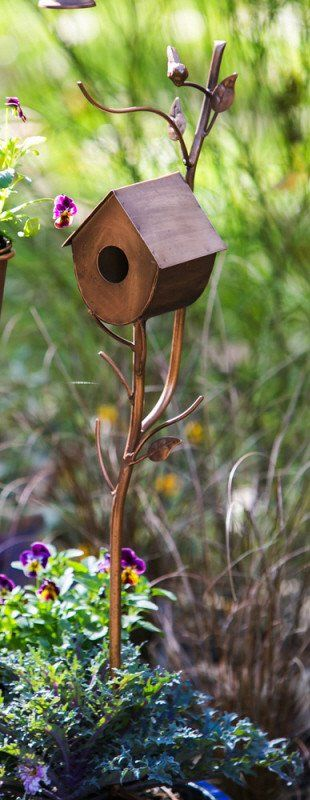 Graceful branches with rustic birdhouse offers a little birdie habitat and delightful garden accent. Unique garden stake features decorative birdhouse on flowing branch with leaves. On the smaller sid