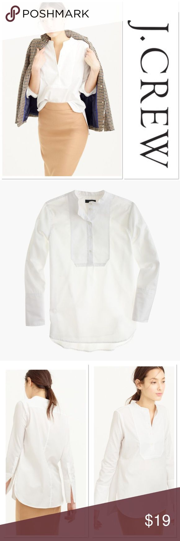 "[J Crew] Petite Pique Bib Shirt White Cotton Tunic What to wear when the day calls for something a bit more refined than a T-shirt? A tux-inspired top in cotton saT-shirtn with a textured bib that easily dresses up or down. Cotton. Long roll-up sleeves. Button placket. Across chest about 16 1/2"". Shirt length about 27"". There is a very small spot underarm where the shirt was unstitched but it has been professionally amended. Not visible because it is underarm of course . Otherwise excellent…"