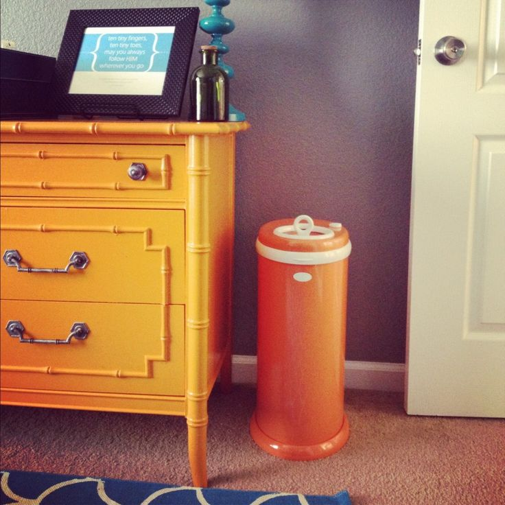 I spy an @Ubbi diaper pail to match the orange accents in this nursery!: Orange Diaperpail, Colors Dressers, Diaperpail Dressers, Diapers Pail, Paintings Dressers, Orange Dressers, Dressers Nurseries, Emerson Nurseries, Bright Colors