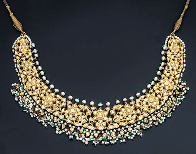 A MODERN DIAMOND AND ENAMEL NECKLACE Designed as openwork diamond-set foliate cluster panels suspending a seed pearl fringe to the polychrome enamelled reverse depicting floral motifs, Jaipur, contemporary, 32.0cm long