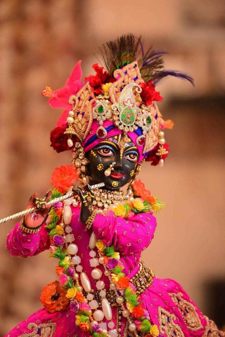 Handsome Krishna in pink attire