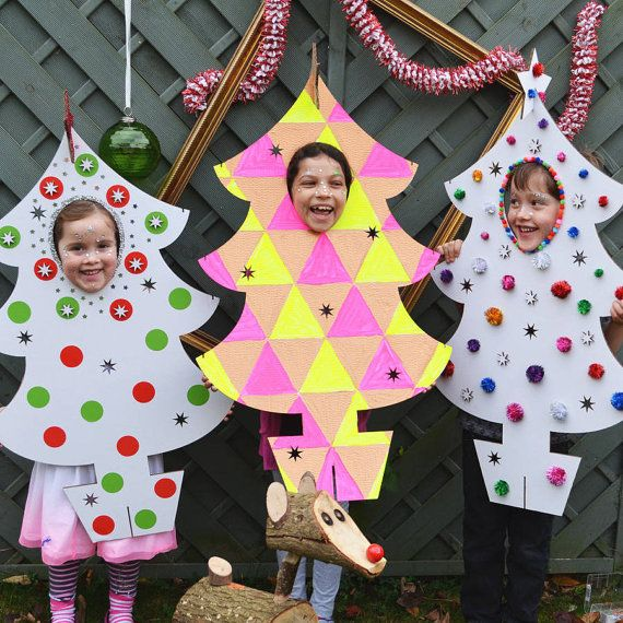 A fun, imaginative photo booth Christmas Tree for all the family to personalise, decorate and peek through! Lasercut corrugated cardboard with add on baubles
