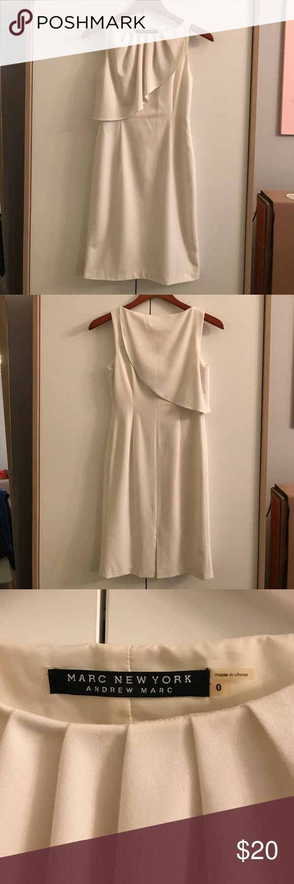Andrew Marc White Sleeveless Dress Marc New York by Andrew Marc white sleeveless dress in size 0. It has a classic yet playful ripple detail around the neckline (front and back as pictured). Hidden side zip. Fully lined. No stains or tears on exterior. The only thing I will note is that the interior of the front neckline has slight discoloration from makeup. I have handwashed but never brought it to dry cleaners so maybe they can get it out? Either way, dress is priced accordingly. Andrew…