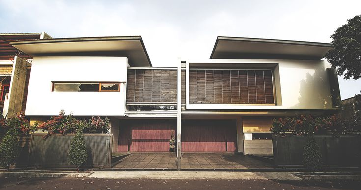 Sister House Image 4. Project : 2628 Sister House Location : Bandung, Indonesia Site Area : 597 m2 Building Area : 600 m2 Design Phase : 2011 Constrution Phase : 2011 - 2013 Description : 2 houses being designed as one building with 2 families live there.  #architect #bandung #jakarta #architectindonesia #archdaily