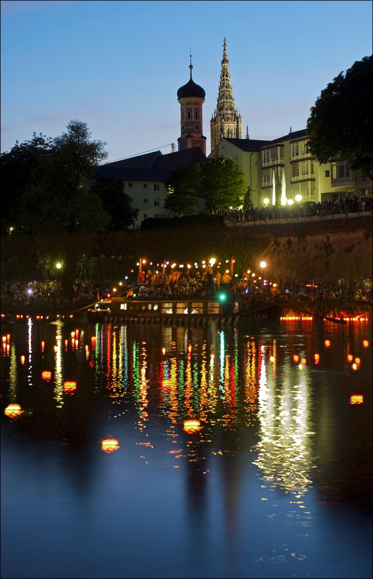 Lights on the Danube river during the city's yearly summer celebrations in Ulm, Germany.