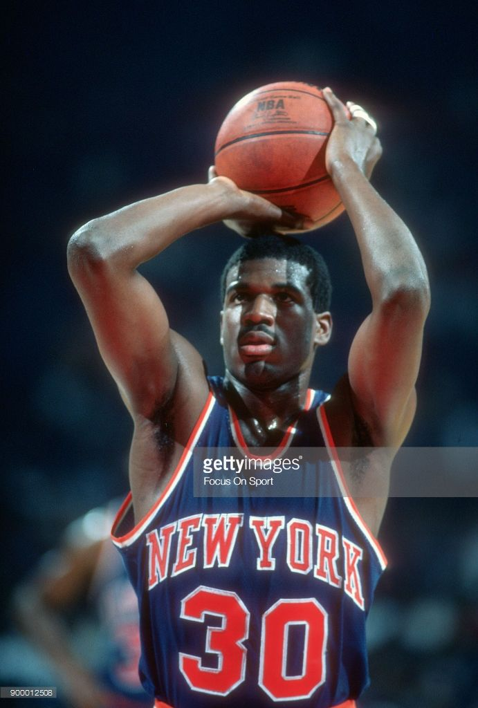 4acc9daa67a5 Bernard King  30 of the New York Knick shoots a free throw against the  Washington Bullets during an NBA basketball game circa 1984 at the Capital  Centre in ...