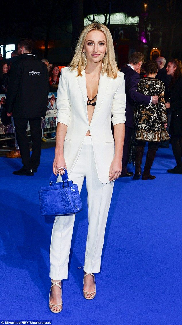 Saucy style: Tiffany Watson, 22, combined fsophistication and sex appeal by sporting a white tuxedo with a skimpy bra underneath as she attended the Another Mother's Son premiere on Thursday