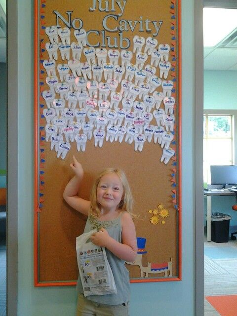 Mahala pointing to her tooth on the July No Cavity Club board!!!