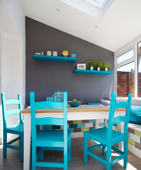 This charcoal feature wall was painted in 00 NN 16/000 and provided the perfect background to showcase the vibrant blue chairs which were painted in 80 GG 27/386. #kitchen #colour #inspiration