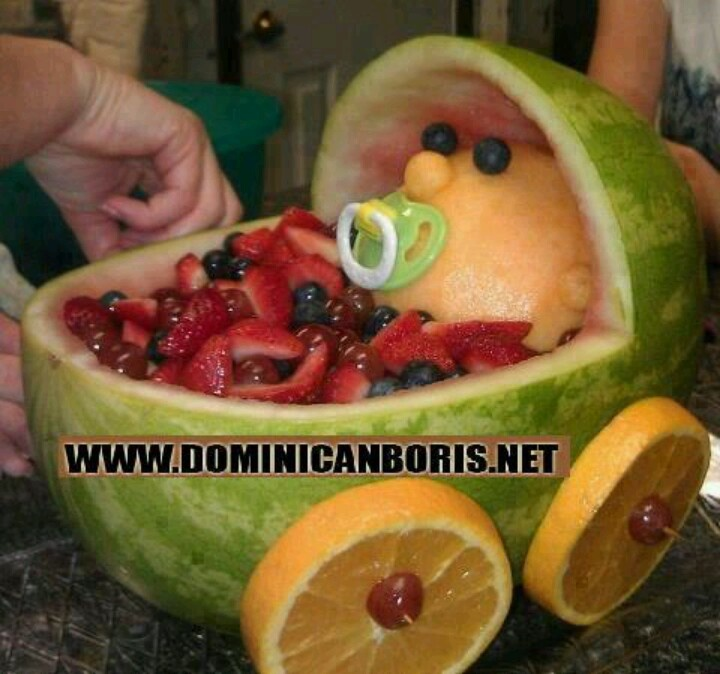 Great for baby showers. Beautiful baby in stroller made from fresh fruits