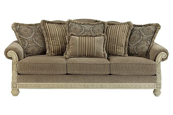 """The Parkington Bay Sofa from Ashley Furniture HomeStore (AFHS.com). With the beautifully shaped padded rolled arms along with the antique finish of the ornate scrolling details, the """"Parkington Bay-Platinum"""" upholstery collection perfectly captures the rich detail of Old World designed furniture without sacrificing the comfort you deserve."""