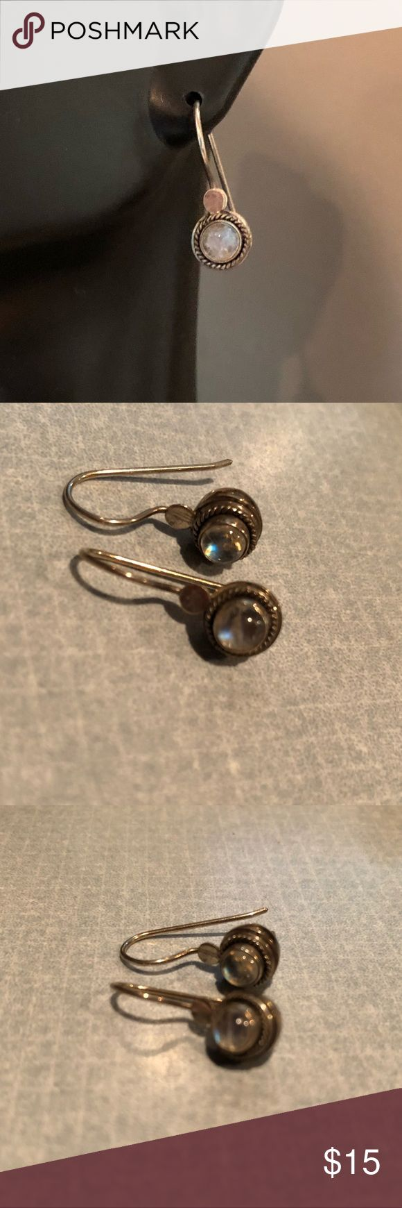 Moonstone Earrings From my personal collection. Lovely moonstones set in Silver with black rope accent. Wires hook on back. Jewelry Earrings