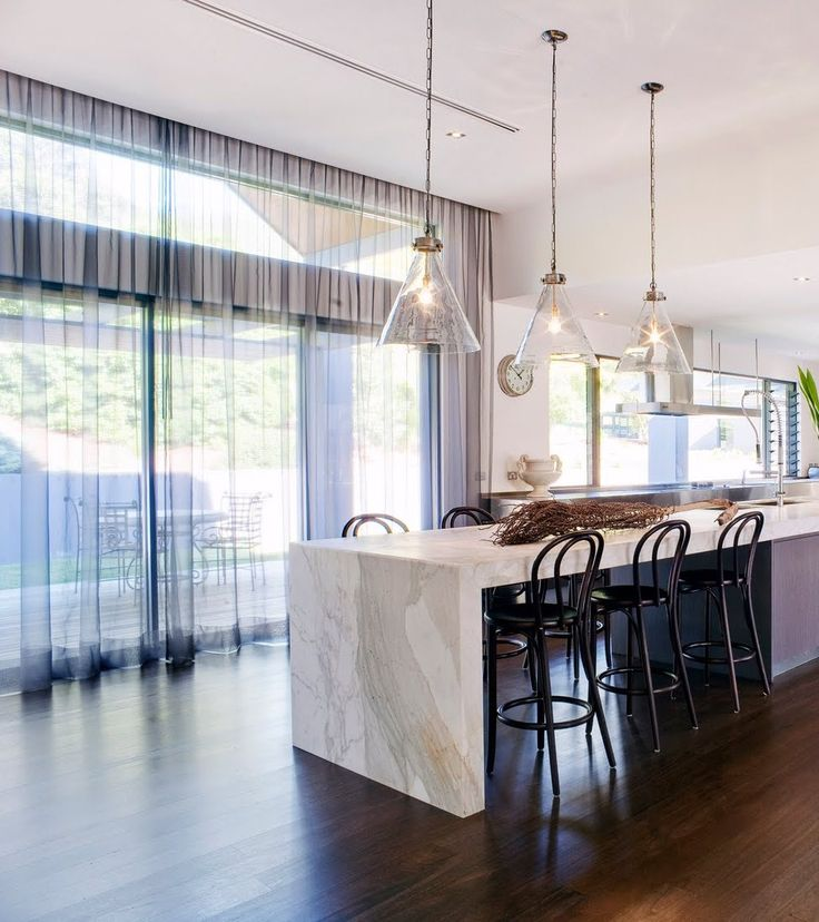 Modern White Kitchen With Island And Pendant Lights: Modern Kitchen, Stone Counter, Stone Bench Top, High