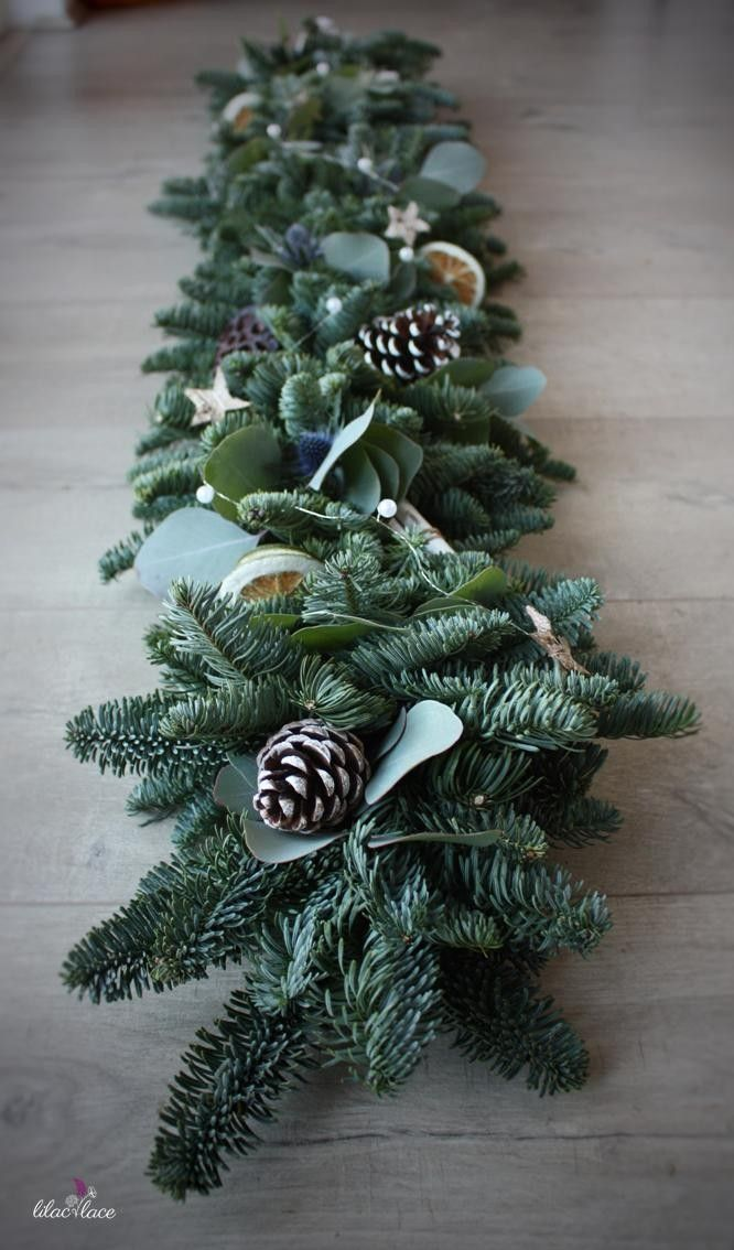 Christmas garland featuring blue Thistle, Pines cones, Birch stars and beads.