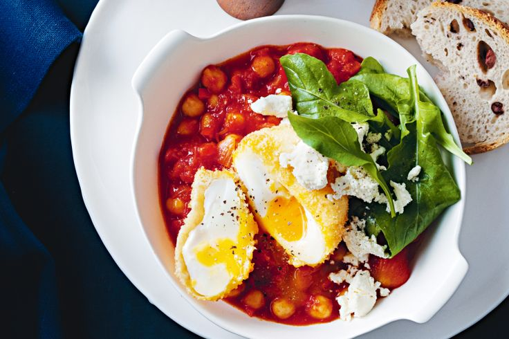 Tomato and chickpea ragout with crumbed eggs