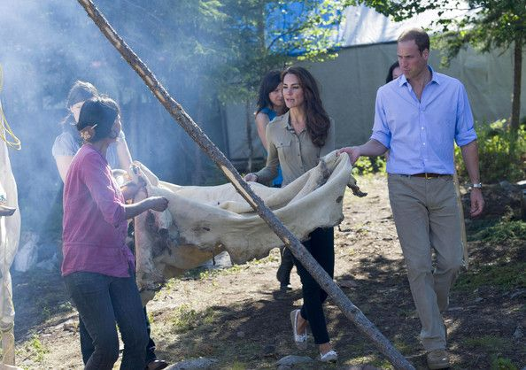 Kate Middleton Photos - Prince William, Duke of Cambridge and Catherine, Duchess of Cambridge help carry a caribou skin to a tent to be smoked during a visit to Blachford Lake near Yellowknife on July 5, 2011 in Blatchford Lake, Northwest Territories, Canada. The newly married Royal Couple are on the sixth day of their first joint overseas tour. The 12 day visit to North America is taking in some of the more remote areas of the country such as Prince Edward Island, Yellowknife and Calgary…
