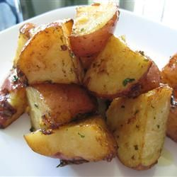 Preheat oven to 450 degrees F. In a large plastic bag, combine 1 envelope onion soup mix, 2 lbs. red potatoes halved and 1/3 cup olive oil. Close bag, and shake until potatoes are fully covered. Pour potatoes into a medium glass baking dish; bake 40 minutes in the preheated oven, stirring occasionally. Can serve with ranch dressing.