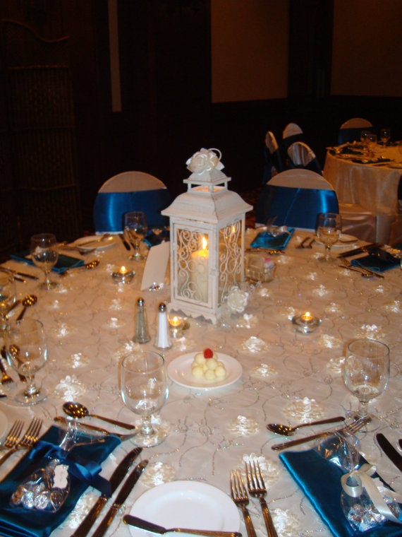 Ivory lantern wedding centerpiece by dubosecenterpieces on