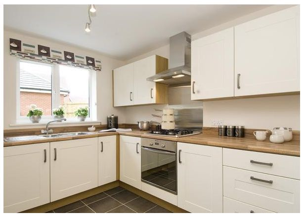 Modern, cream shaker-style units and beech wood worktop in this modern, new home kitchen. #newhomes #kitchens