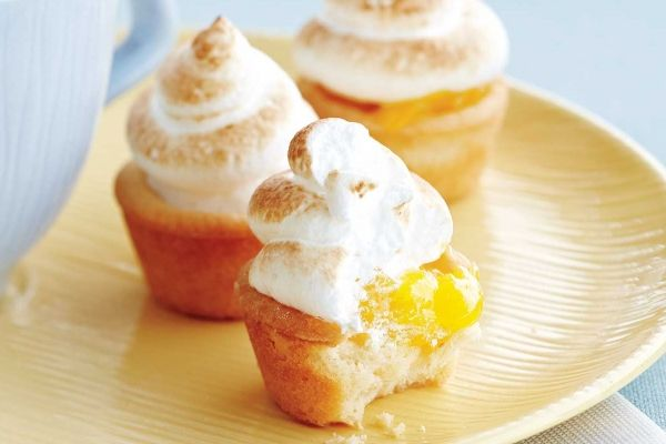 Mini Lemon Meringue Tarts - A shortbread crust makes easy work of these pretty little tarts. Simply roll the dough into balls to press into mini muffin cups -- no finicky pastry to roll and cut. Plus, the buttery crust pairs wonderfully with the citrusy lemon zing of the filling.