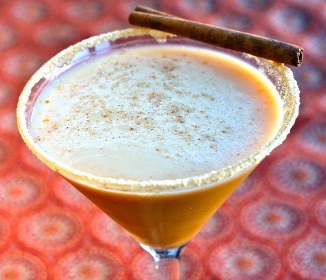 Pumpkintini:  - 2 shots Vanilla or Whipped Cream vodka  - 1 shot Kahlua (or other coffee flavored liquor)  - 2-3 Tablespoons pumpkin puree  - 1/2 cup of milk  - honey  - crushed graham crackers (food processor works best!)  - ice  - pinch pumpkin pie spice  - cinnamon stick (for garnish)