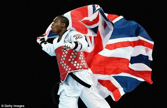 Flying the flag: East Londoner Lutalo Muhammad landed the bronze medal at the ExCel in taekwondo repechage when he beat Iran's Yousef Karami.