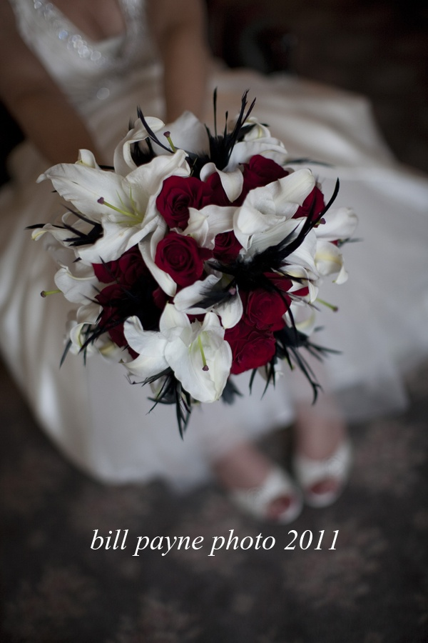 bridal bouquet red roses casablanca lilies and black feathers floral design by weddings