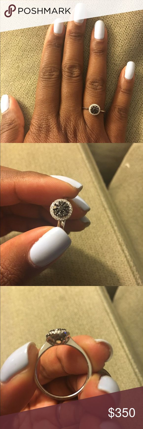 White gold and black and white diamond ring I bought this ring as a post-bar exam present for myself, but I no longer wear it often. I bought it in 2012 on board on a cruise ship. It came with authentication papers, which I will post if I can find them. Please feel to make reasonable offers! Jewelry Rings