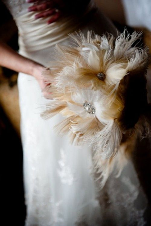 Feathers were a big part of the 20's and Gatsby - could be awesome if done right!!  40 Unique And Non-Traditional Wedding Bouquets | Weddingomania