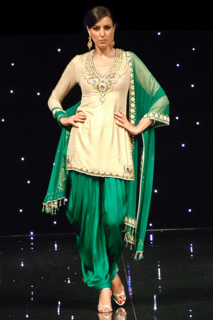 Bridal Garments by Satya Paul. Emerald green net dupatta with jewel borders and emerald Patiala salwar. Gold foiled kurta with beautiful bejeweled neckline and hem.