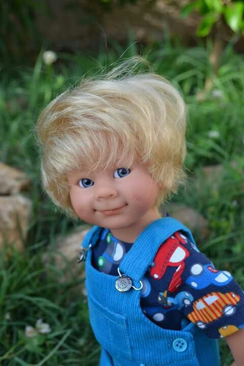 A boy  For handmade dolls that have interchangeable eyes and mouths, visit jessicadolls.com!