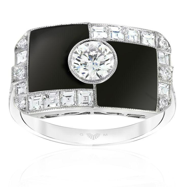 Noir onyx and diamond dress ring. Inspired by the striking geometric designs of the Art Deco period. Featuring round and carre cut diamonds in this unique design. Embellished with mille graining around the diamonds. Crafted in Platinum. This ring will be customised to perfectly fit your finger, which may take up to 6 weeks.