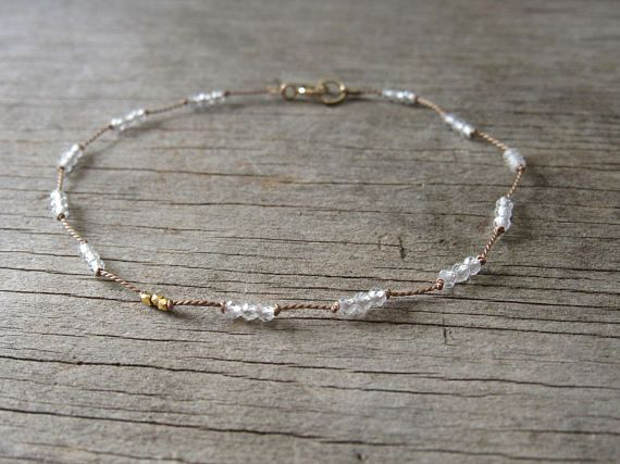 The tiniest clear quartz gemstones are carefully hand knotted in place on a thin beige silk cord. 24k gold vermeil nugget accent beads accompany the quartz for this delicate looking bracelet. Makes a perfect everyday bracelet or for a precious gift!  Quartz gemstones are very tiny and faceted at 2 mm. Nice quality clear stones. 24k gold vermeil nuggets are very tiny at 1.3 mm. A gold filled spring ring clasp finishes the bracelet.  Please choose your length from the drop down menu. Gift…