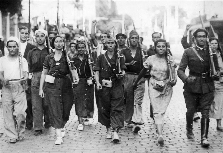 "1936: The Spanish Civil War breaks out with a military uprising in Morocco on July 17, triggered by events in Madrid. Within days, Spain is divided in two: a ""Republican"" or ""Loyalist"" Spain consisting of the Second Spanish Republic (within which were pockets of revolutionary anarchism and Trotskyism) and a ""Nationalist"" Spain under the insurgent generals, and, eventually, under the leadership of General Francisco Franco. Male and female militia fighters march in July."