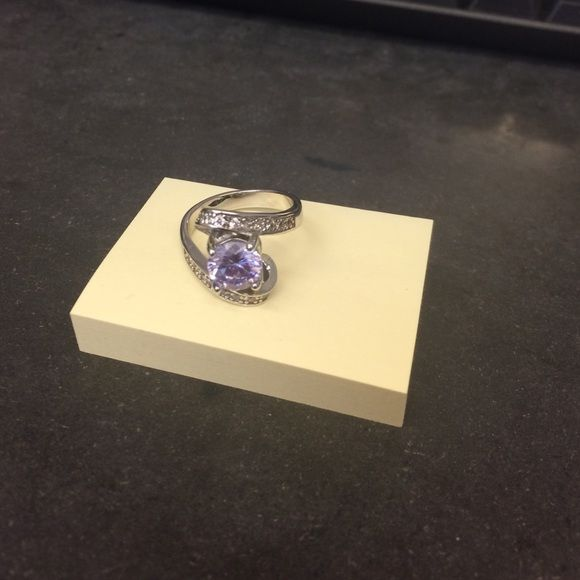Purple stone fashion diamond candle ring Purple stone bling fashion ring. About a size 7 3/4. From a diamond candle Jewelry Rings