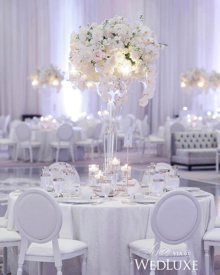 Equal parts dreamy and modern, what is there not to love about this #centrepiece? | Photography By: LifeImages | WedLuxe Magazine | #wedding #luxury #weddinginspiration #luxurywedding #centrepiece #centerpiece #tablescape #table #decor #eventdecor #white #floralarrangement