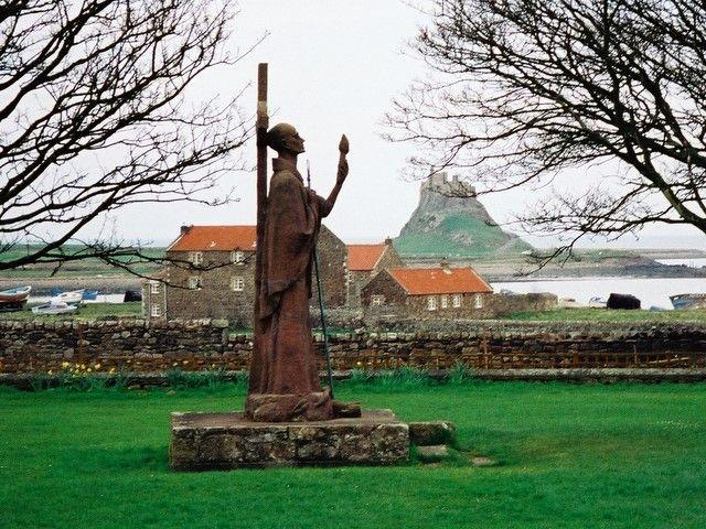 St Aidan with Lindisfarne Castle behind - Lindisfarne